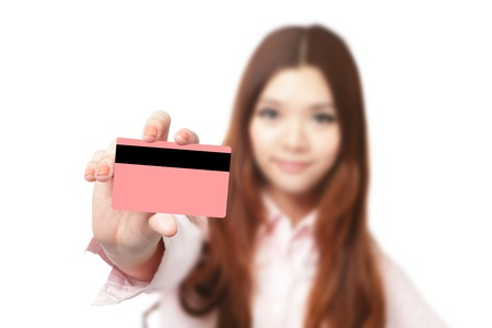 Young Business woman smile and take credit card isolated on white background, Model is a asian beauty photo