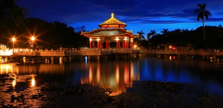 chinese pagoda: Chinese style pavilion in the night with reflection of light Stock Photo