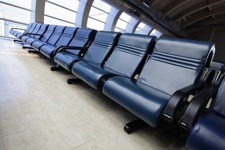 row of blue chair at airport photo