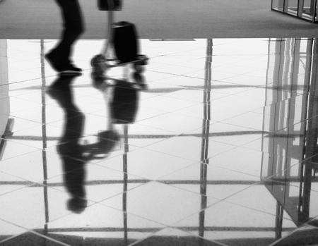 passenger (Man) rushing through an airport terminal photo