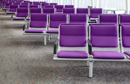row of purple chair at airport in Hongkong photo
