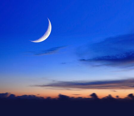 crescent moon with beautiful sunset background photo