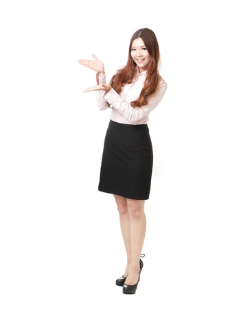 present presentation: Full length of pretty business woman giving presentation isolated on white background, model is a asian female