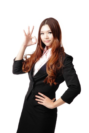 Perfect - business woman showing OK hand sign isolated on white background. Young pretty Asian businesswoman  photo