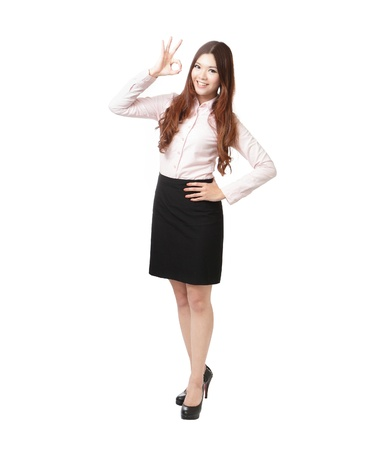 Full length of business woman showing OK hand sign happy smile isolated on white background. Young pretty Asian businesswoman  photo