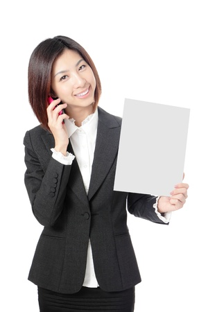 Beautiful Business woman take blank paper and speaking mobile phone isolated on white background, model is a asian beauty Stock Photo - 11966950