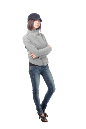 Cool young girl with blue jeans isolated on white background, model is a asian beauty Stock Photo - 11966928
