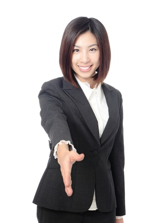 Successful business woman holds out her hand to greet. Isolated over white background photo