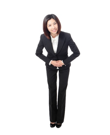 chinese woman: Full length of attractive business woman take a bow isolated on white background, model is a asian beauty Stock Photo