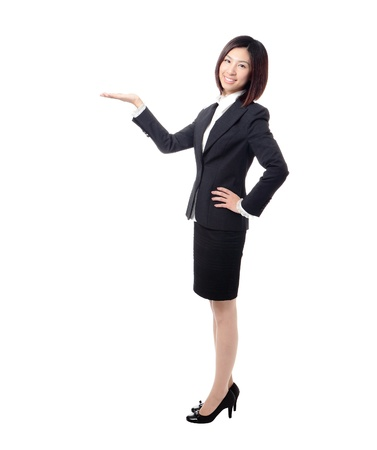 Full length Business woman introducing something by hand isolated on white background, model is a cute asian photo