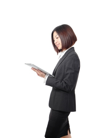 Young Business woman smile using tablet pc isolated on white background, model is a asian beauty photo