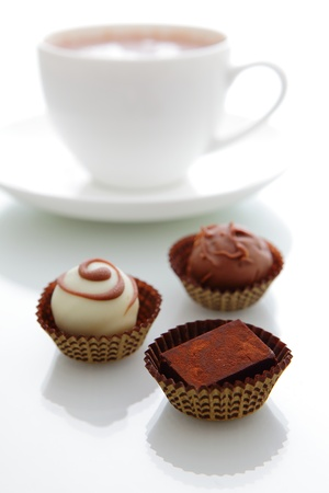 delicious handmade chocolate with a cup of coffee photo