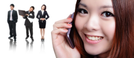 Young business woman speaking mobile phone with sweet smile with business background, model is a asian beauty photo