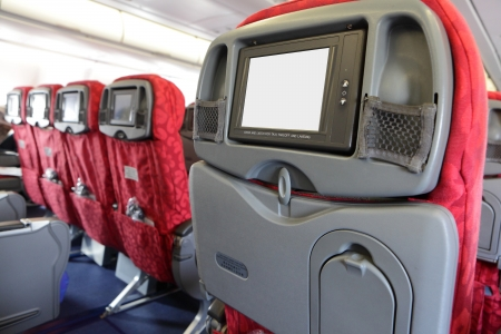 back screen: LCD monitor on Passenger Seat of air plane Editorial