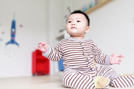Cute Baby Look Up forward with home background, Baby is a cute asian child photo
