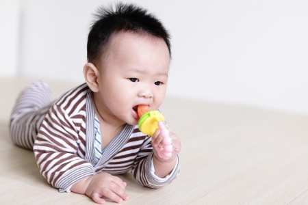 crawling: Cute Baby crawling on living room floor with home background, baby is a cute asian child Stock Photo