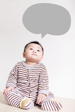 Cute Baby thinking and look up forward, baby is a cute asian child photo