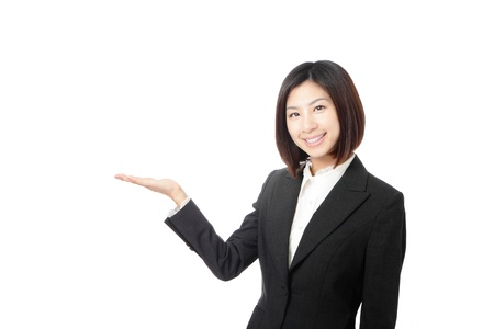 Beautiful Business woman introducing something by hand isolated on white background, model is a asian beauty Stock Photo - 12209148