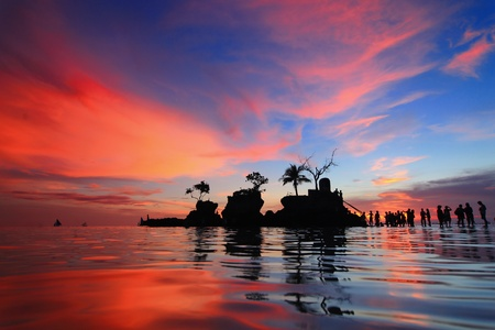 beautiful sunset and sea with tourist, shot in Boracay, Philippines, Willy Stock Photo - 12209229