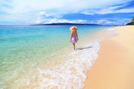 beach hat: beautiful girl at the beach with sunny sky, cloud shot in Boracay  Philippines Stock Photo