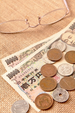 japanese yen: japanese yen (ten thousand money) with eyeglasses