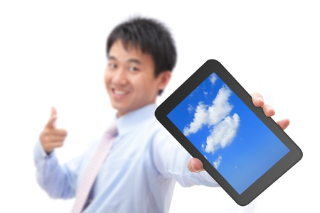 Business man show tablet pc with smile (tablet pc screen display sky and cloud), for cloud computing concept Stock Photo - 12209301