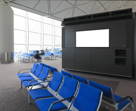 billboard blank: blank billboard and blue chair waiting room at a international airport with busy traveler
