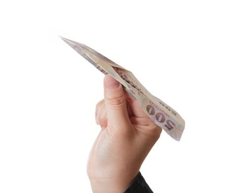 Hand take money plane isolated on white background photo