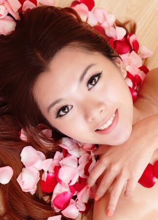Asian beauty Girl smiling close-up with rose background, Beautiful young woman touching her face looking to the camera Stock Photo - 12209019