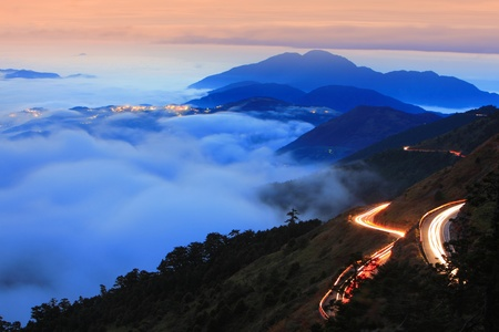 Dramatic cloud with mountain and road car traffic with sunset background shot in taiwan asia photo
