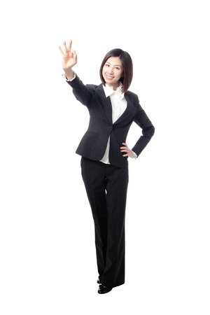 perfect sign: Perfect - business woman showing OK hand sign smiling happy. Young pretty Asian businesswoman isolated on white background. Stock Photo