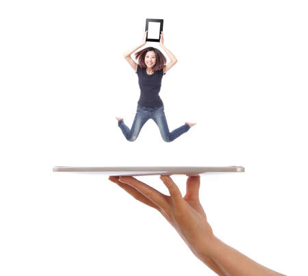 touch pad: Young girl jump and showing tablet pc on people hand isolated on white background, model is a asian beauty