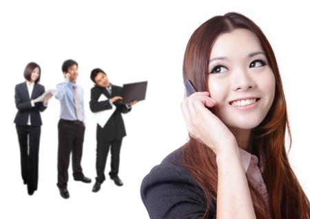 Young business woman speaking mobile phone with sweet smile with business background, model is a asian beauty Stock Photo - 12527893