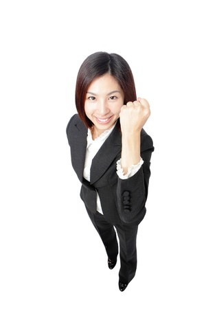 Success winner business woman full length isolated. Funny image of celebrating happy young businesswoman in full length with her arms up. photo