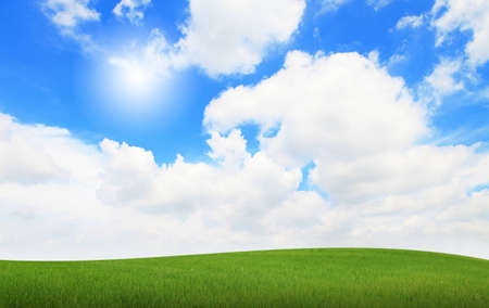 green grass with blue sky and sunshine Stock Photo - 12527742