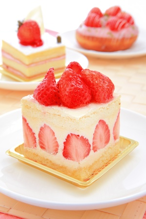 mousse: Dessert - sweet cake with strawberry on a plate