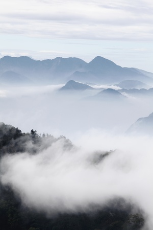 mountains with trees and fog in monochrome color shot in taiwan asian Stock Photo