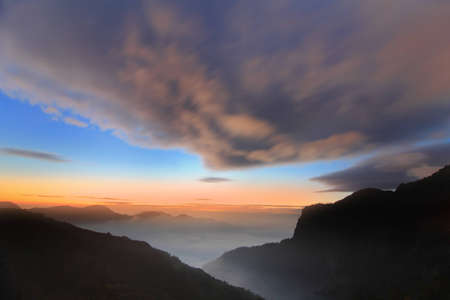 dramatic Clouds rolling over mountains at sunset shot in taiwan formosa asia Stock Photo - 12528249