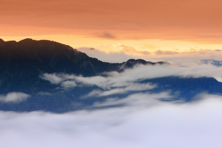 Dramatic clouds with mountain silhouette with sunset, shot in Taiwan, Asia. Stock Photo - 12528617