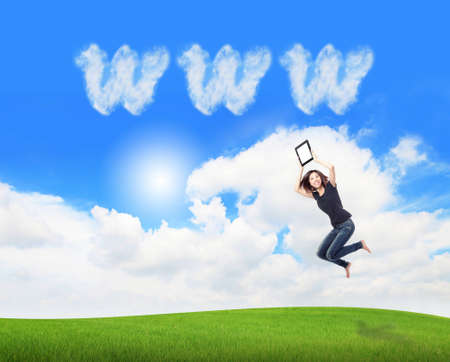 internet explorer: Young beauty happy jump and showing tablet pc in the air on meadow with www cloud sky background , model is a cute asian, for cloud computing concept Stock Photo