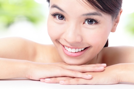 portrait of attractive woman smile with green background , model is a asian beauty Stock Photo - 12528951