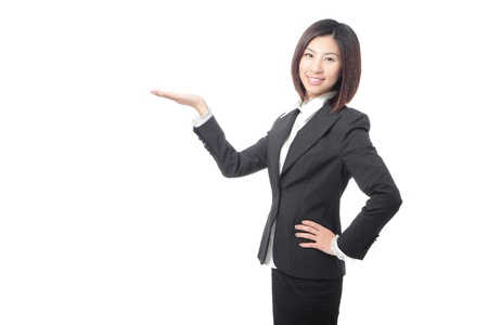introducing: young business woman introducing something, isolated on white background, model is a asian beauty Stock Photo