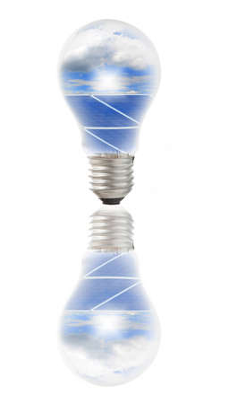 environmental issue: Lamp bulb with solar panels and blue sky and white cloud inside. Conceptual image for Environmental issue Stock Photo
