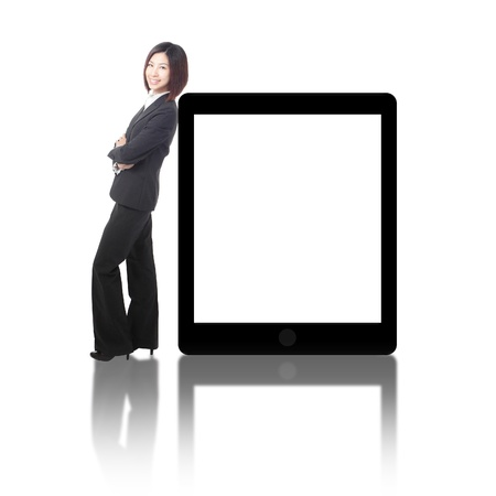 web screen: Business woman smile and standing with tablet pc ( blank screen ), model is a asian beauty Stock Photo