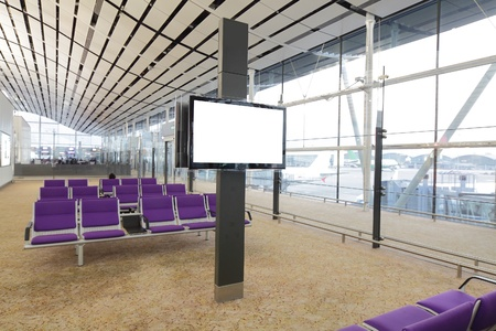 display advertising: LCD TV  white screen  and row of purple chair at airport in Hongkong Editorial