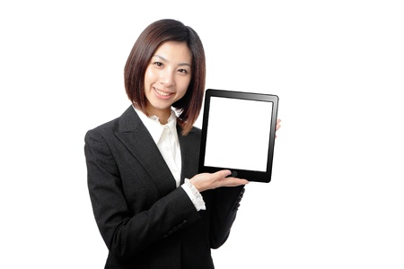 Business woman smile and showing tablet pc isolated on white background, model is a asian beauty Stock Photo - 12759212