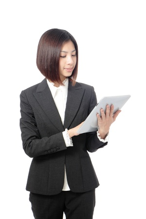 happy business woman using tablet pc computer isolated on white background, model is a asian beauty photo