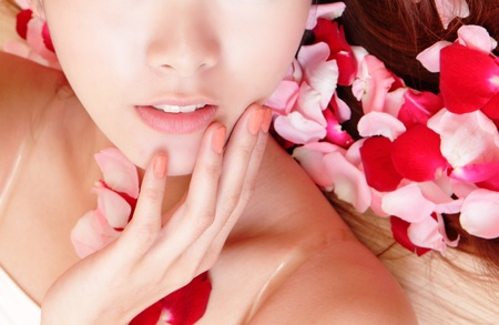 Close-up of woman beautiful lips with pink and red roses, model is a asian beauty photo