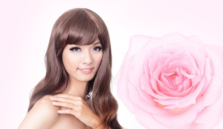 face close up: Beautiful Girl smile face close up with pink rose background, model hand touch her shoulders, model is a asian beauty Stock Photo