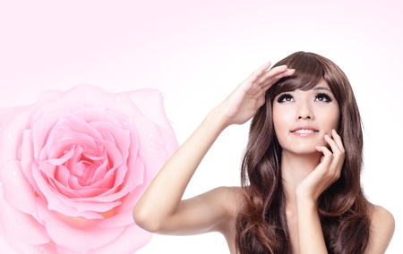 Beautiful Girl smile face close up with pink rose background,model look up forward, model is a asian beauty Stock Photo